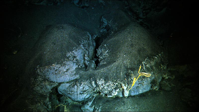 Unconsolidated pyroclastic deposits blanketing a pillow lava.