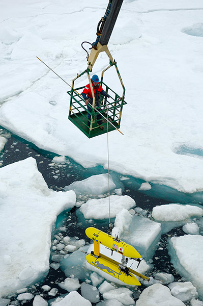 The PUMA AUV on the ship's crane prior to an under-ice mission. Photo: Björn Eriksson