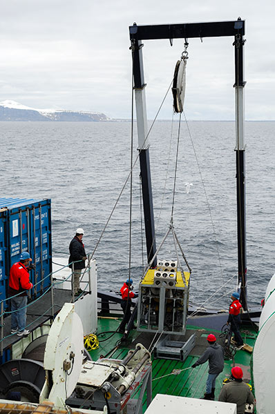 The CAMPER wireline vehicle being lowered over the side during a test dive off Bear Island. Photo: Björn Eriksson.