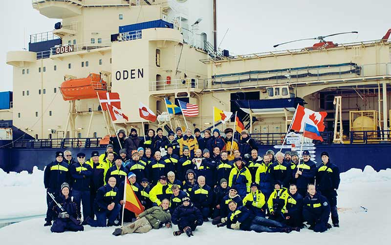 Oden reached the geographical North Pole on August 22 at 21:04 (UTC). The arrival at the North Pole was celebrated by raising the flags of the countries represented onboard Oden. After a glass of champagne on the bridge and a group photo on the sea ice in front of Oden, the expedition continued its scientific program. Photo: Adam Jeppesen