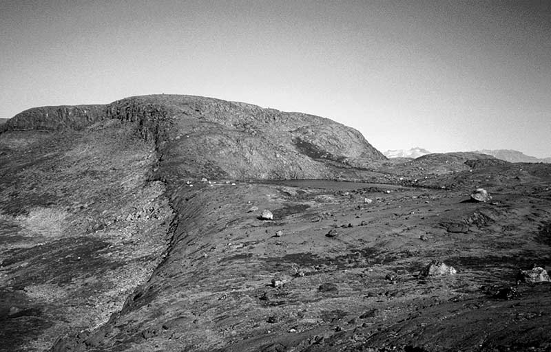Glacially scoured basalt hills near the Mestersvig air-field, covered by erratic boulders which date the final, post-LGM, deglaciation of the area. Photo: Lena Håkansson