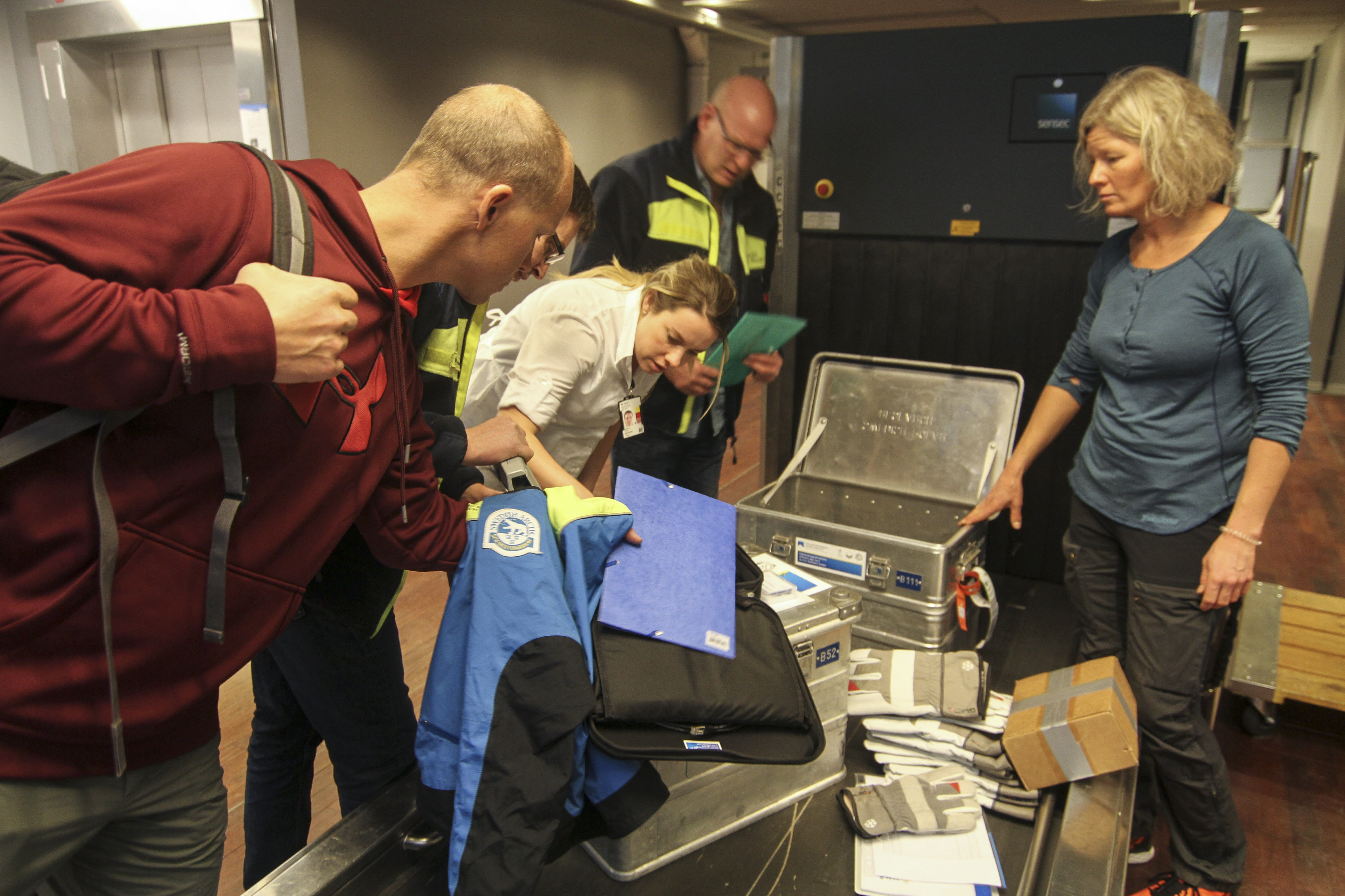 Everyone at the airport wants to open the aluminum boxes to see what's in it. Photo: Carl Lundberg