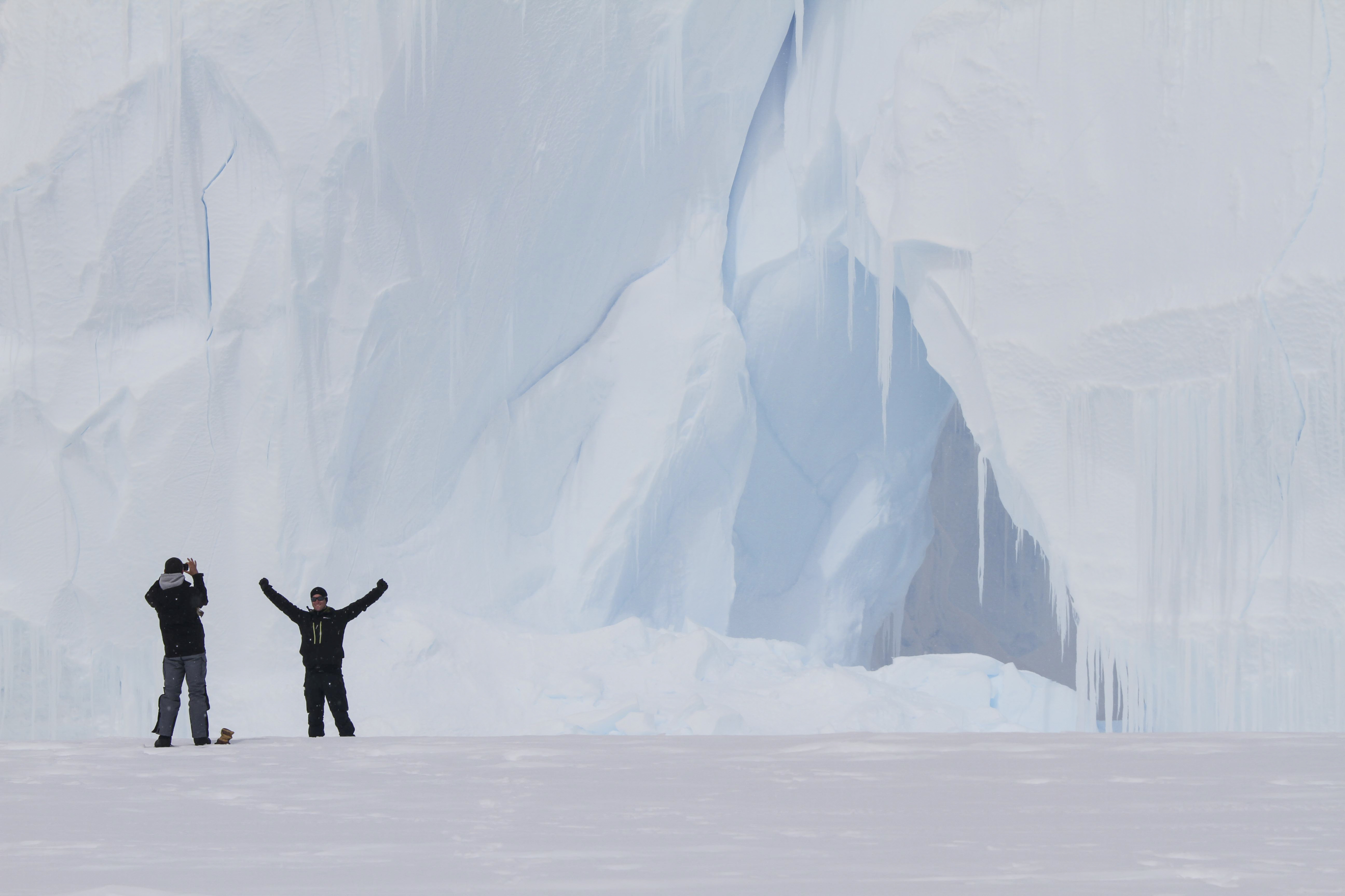 Man in front of a gigant ice cave