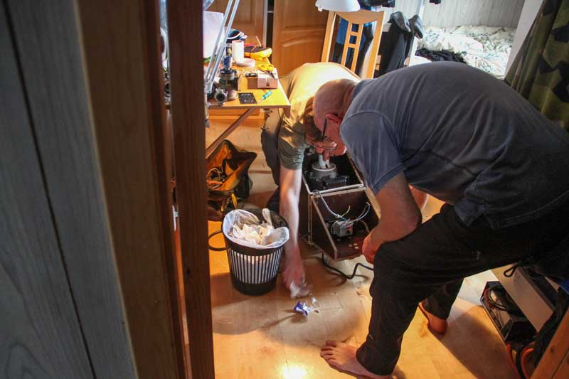 The water pump getting repaired. When the trash can tip over you know its time to go for the day. Photo: Carl Lundberg