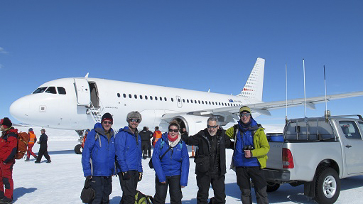 Participants in front of the airplane