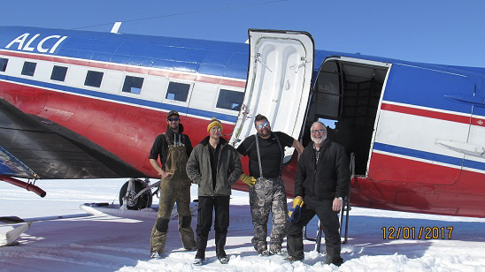 Crew in front of airplane