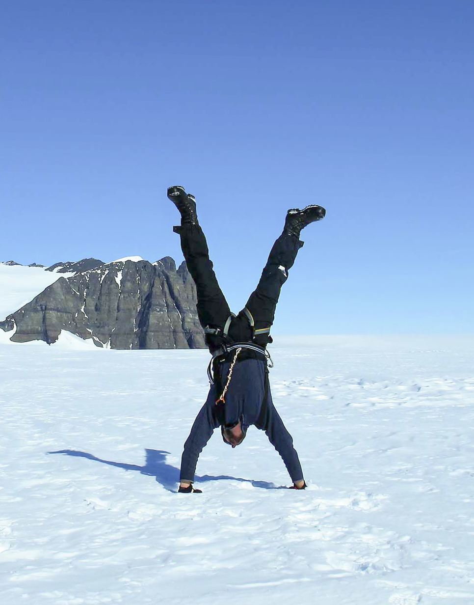 Hand stand on the ice