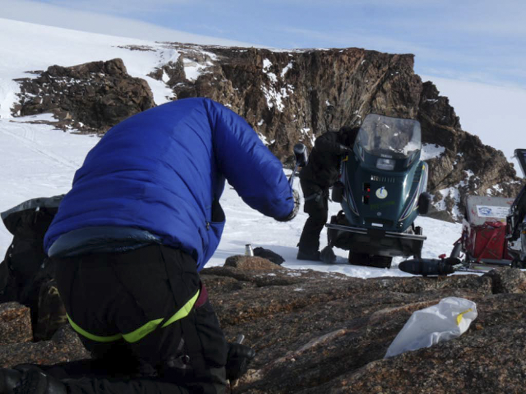 Collecting samples in Antarctica with hammer and chisel
