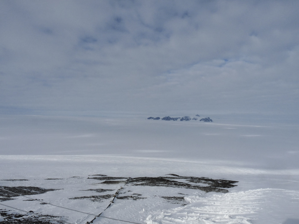 Looking down to the ice runway at Wasa, Antarctica. The nunatak Basen in the background
