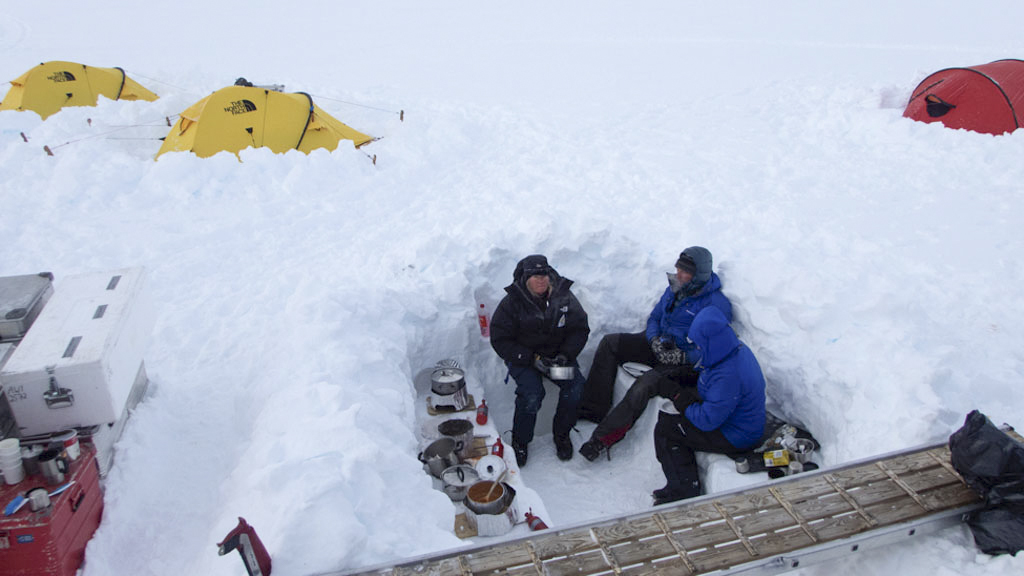 Eating dinner in Antarctica is cold, we've dug out a kitchen area to protect us from the wind.