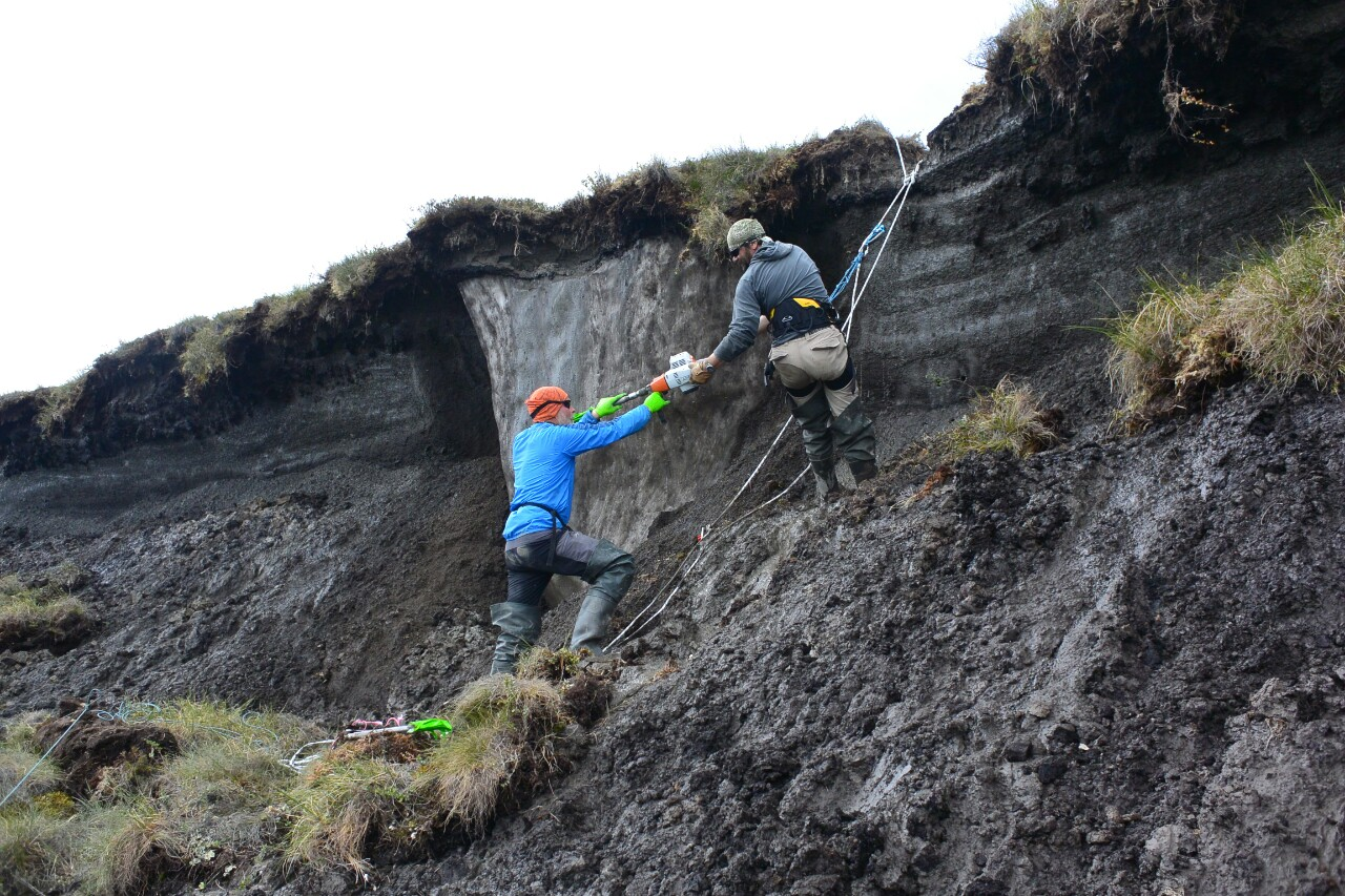 handing over a sediment core