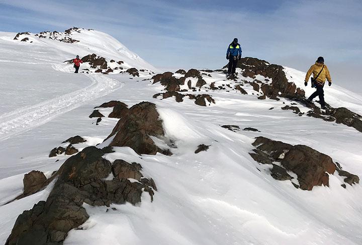 Researchers on a ridge