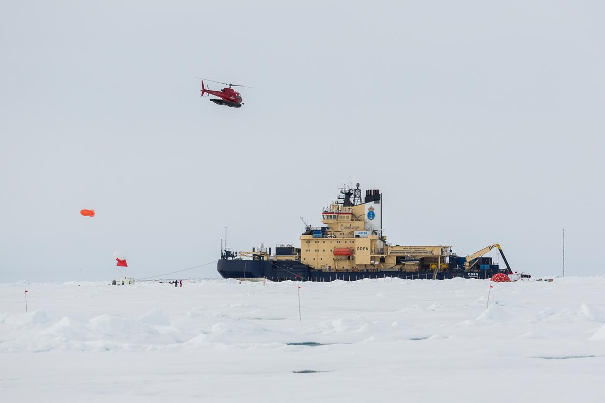 Helicopter above icebreaker Oden