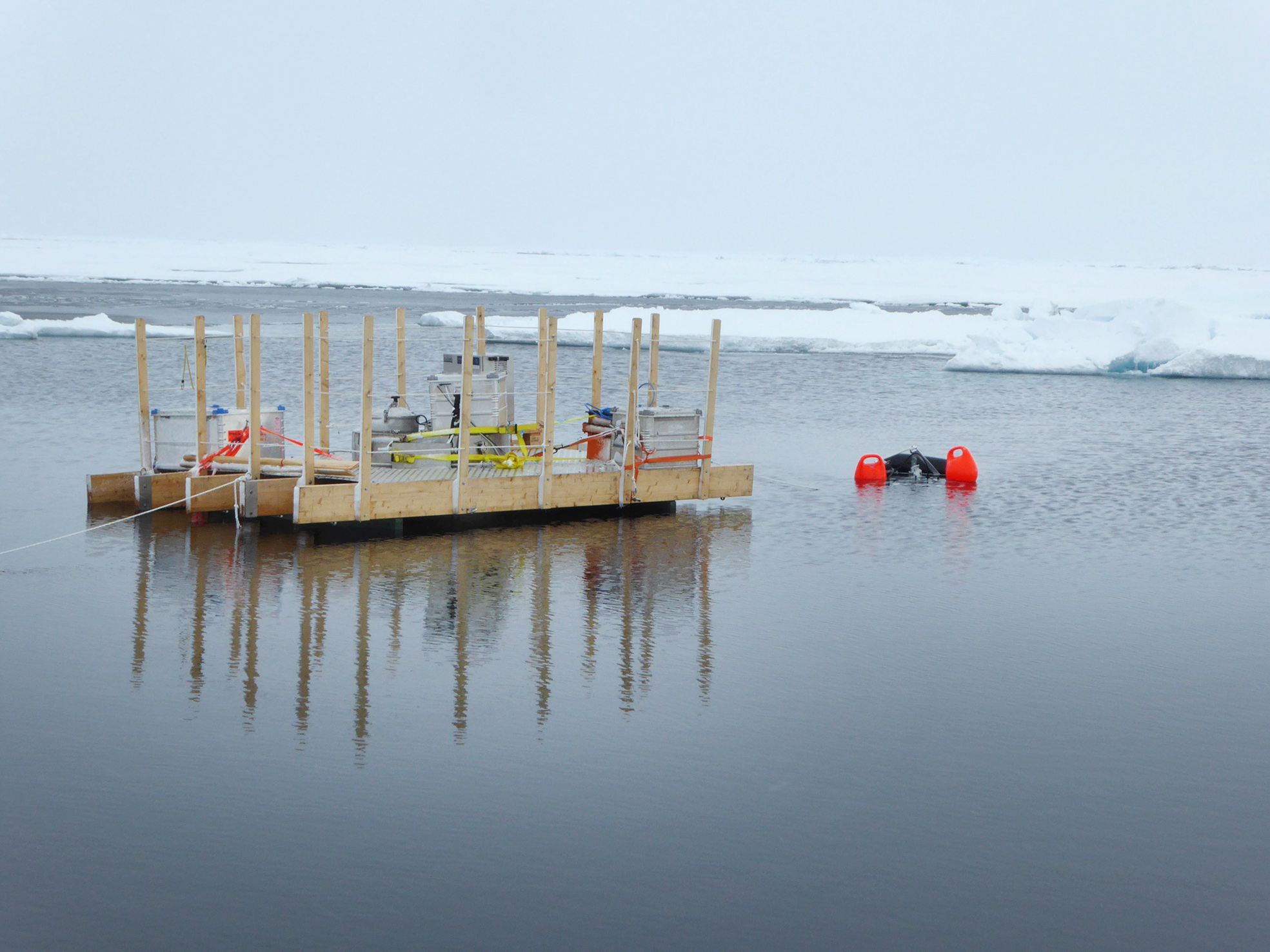 The floating aerosol chamber and the bubble camera making measurements in a patch of open water. Photo: Helen Czerski