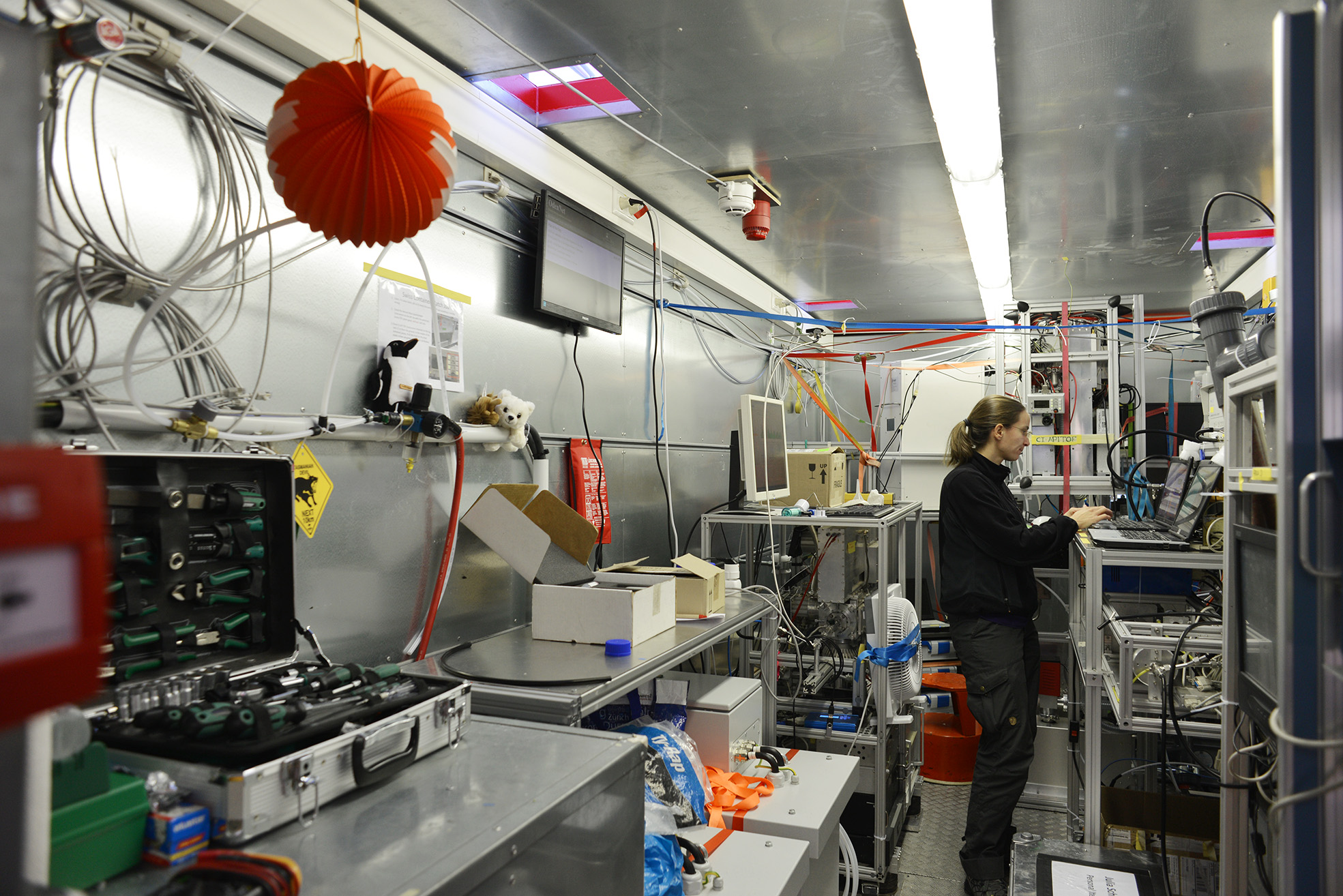 Julia Schmale working inside the Swiss lab-container with aerosol instrumentation in the background. Photo: Paul Zieger